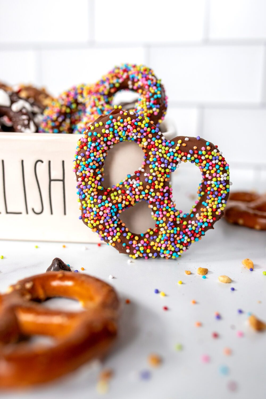 chocolate covered pretzel with rainbow sprinkles