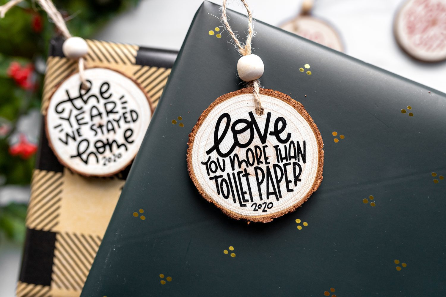 gifts wrapped with wood slice ornaments