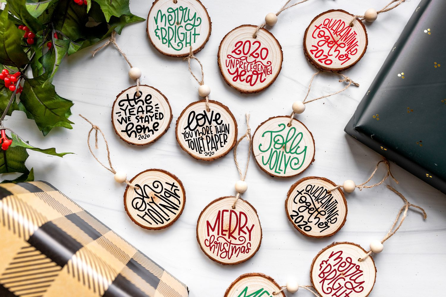wood slice ornaments decorated with cricut vinyl