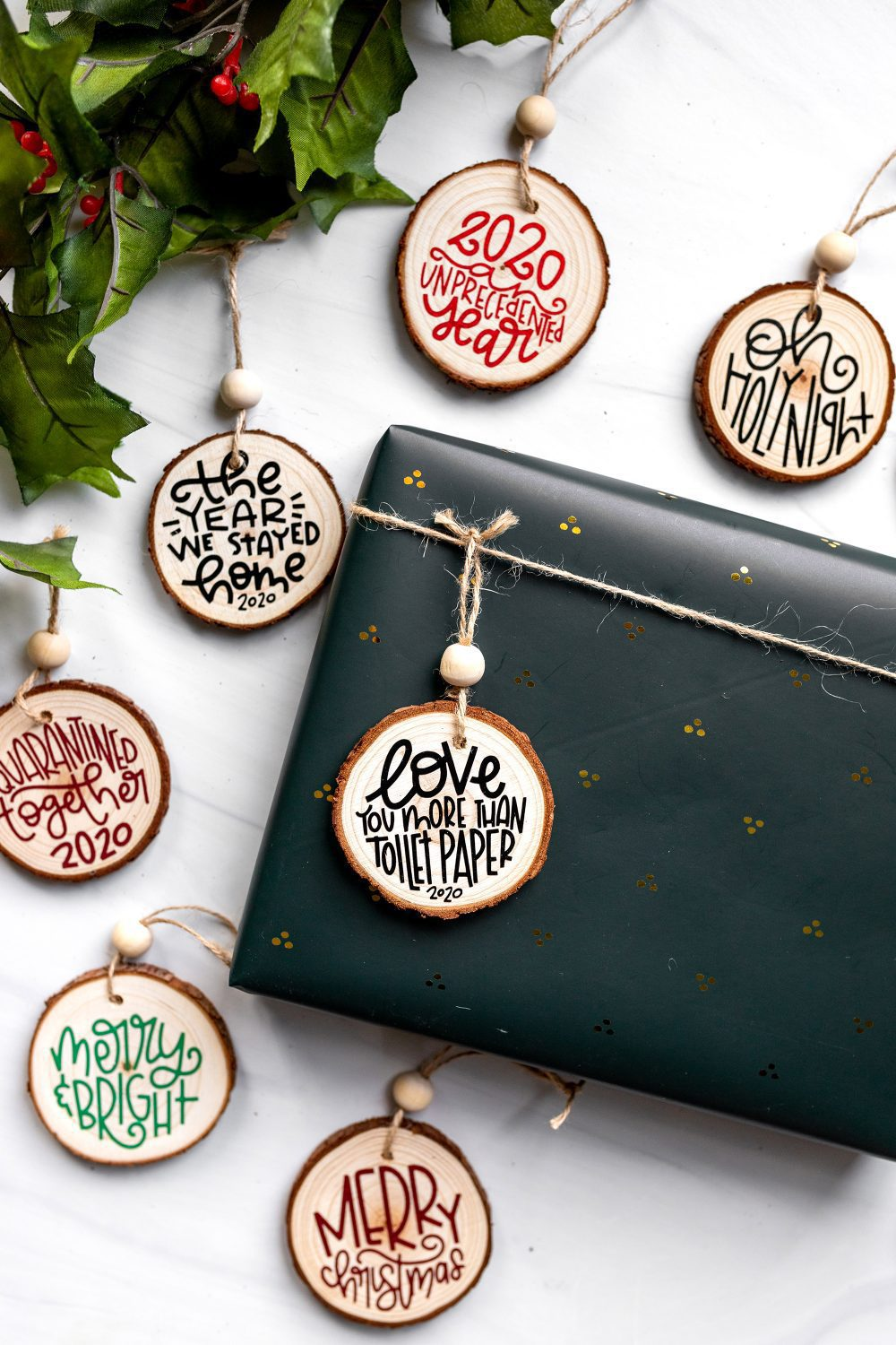 ornaments made with wood slices and a cricut joy