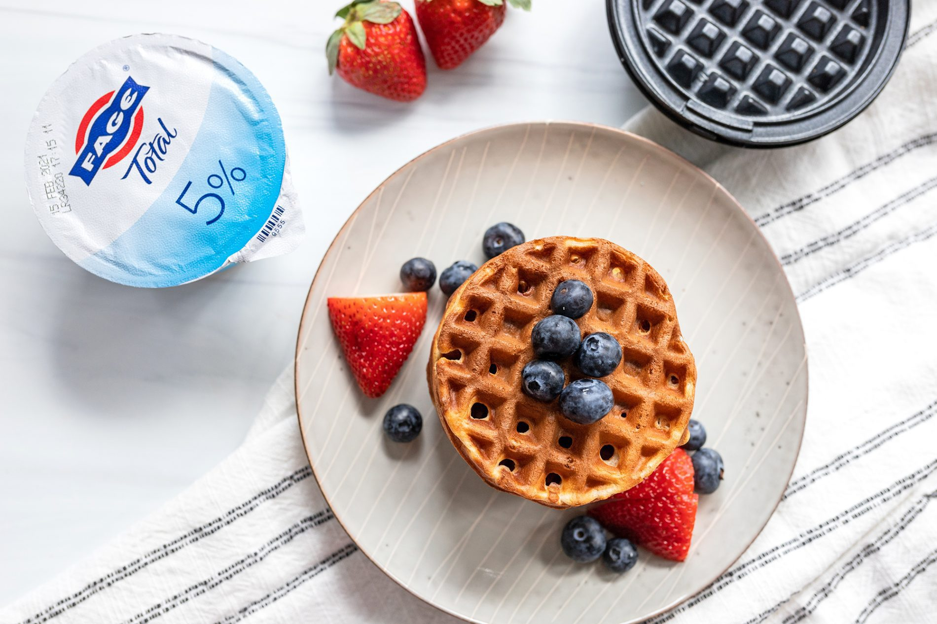 plate of greek yogurt waffles with berries