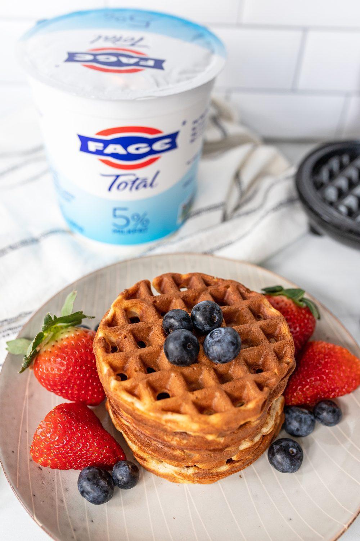 plate of greek yogurt waffles with berries and FAGE yogurt