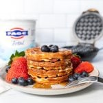 plate of waffles in front of FAGE yogurt