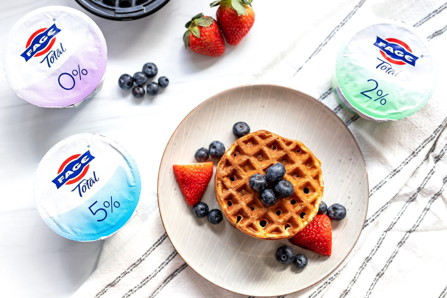 aerial view of a plate of waffles and FAGE yogurt