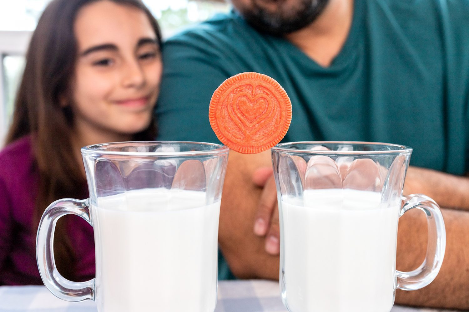 Lady Gaga OREO Cookie balancing on top of two cups of milk