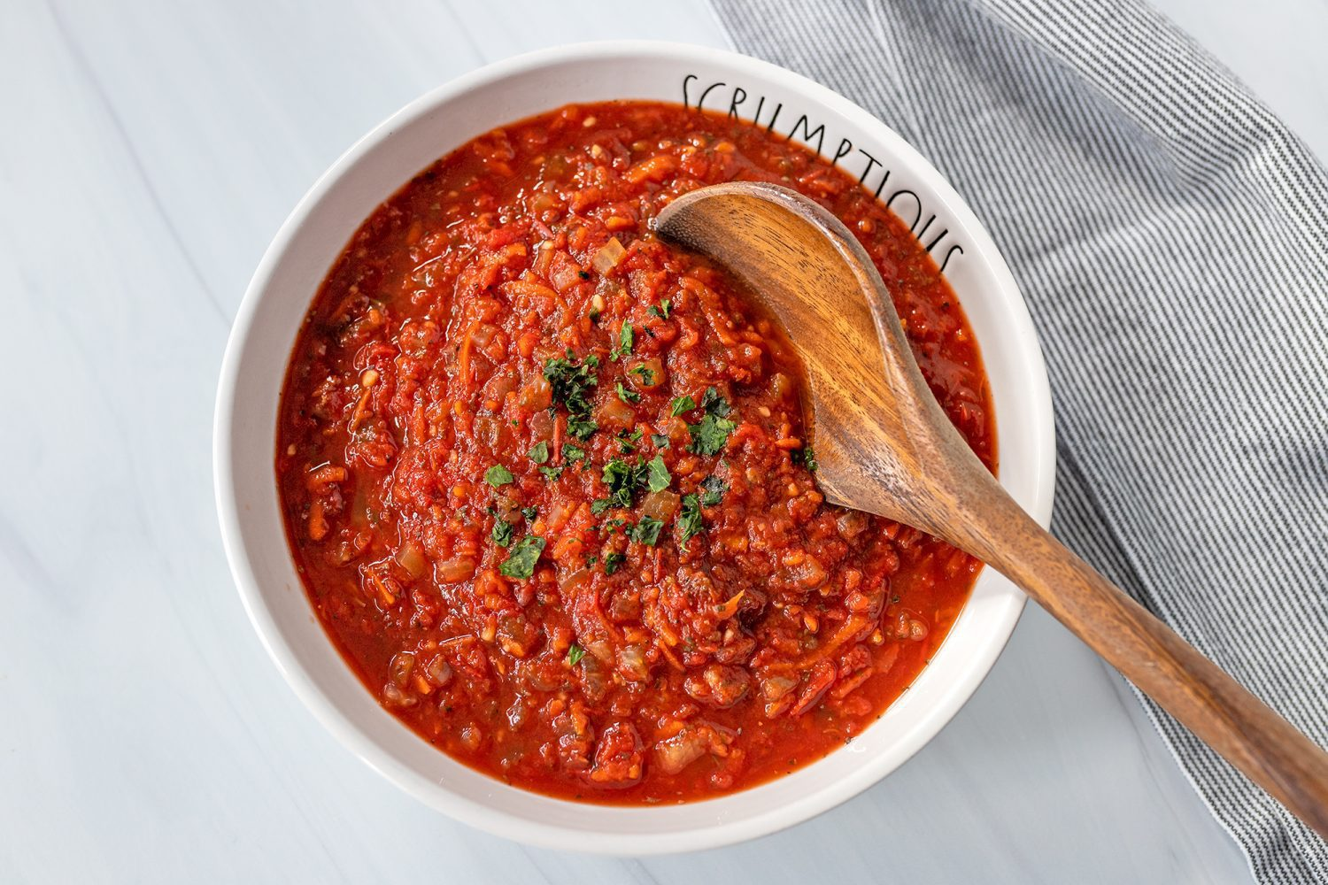 bowl of slow cooker pasta sauce with fresh basil