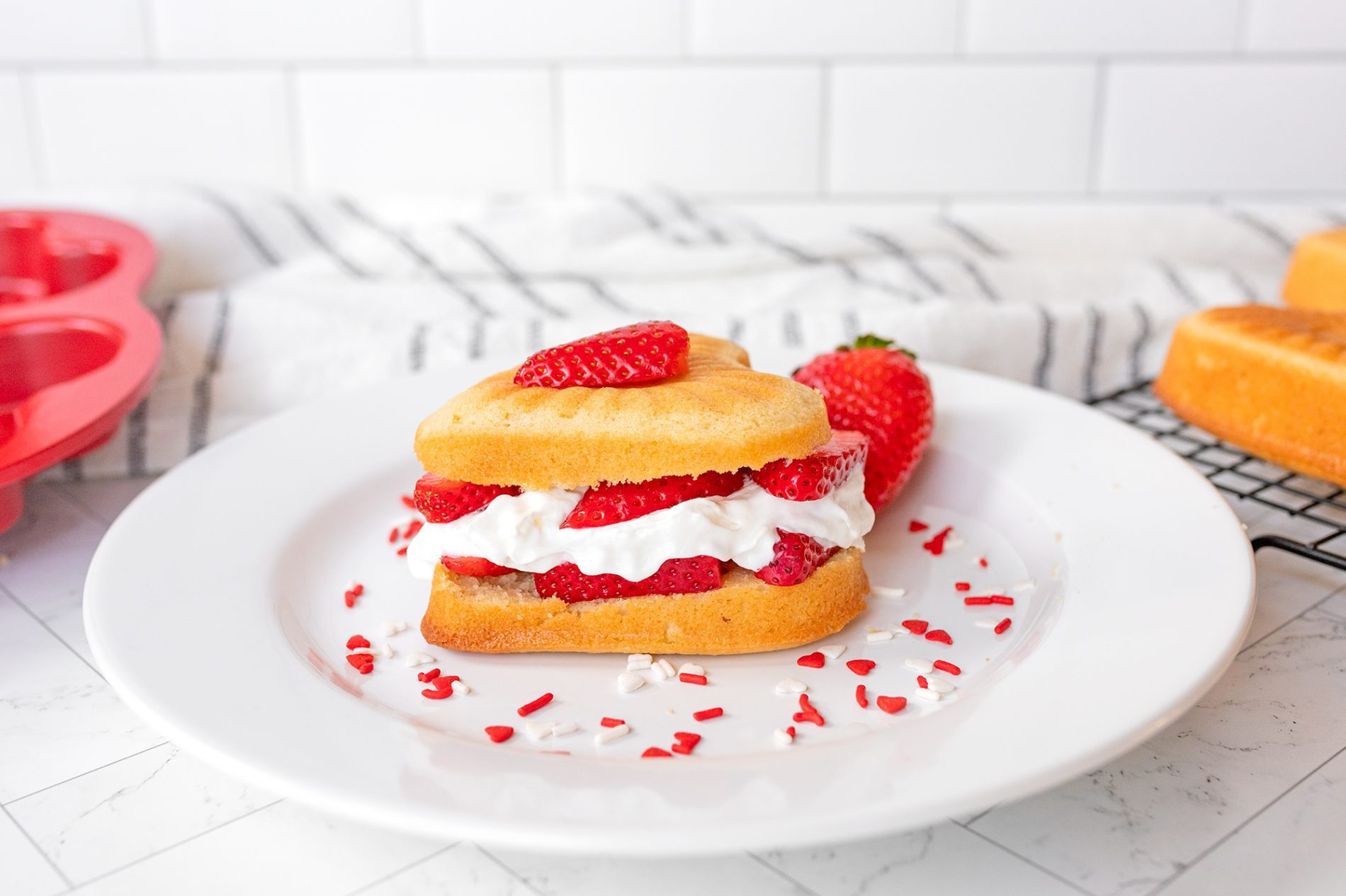 heart shaped strawberry shortcake on a plate
