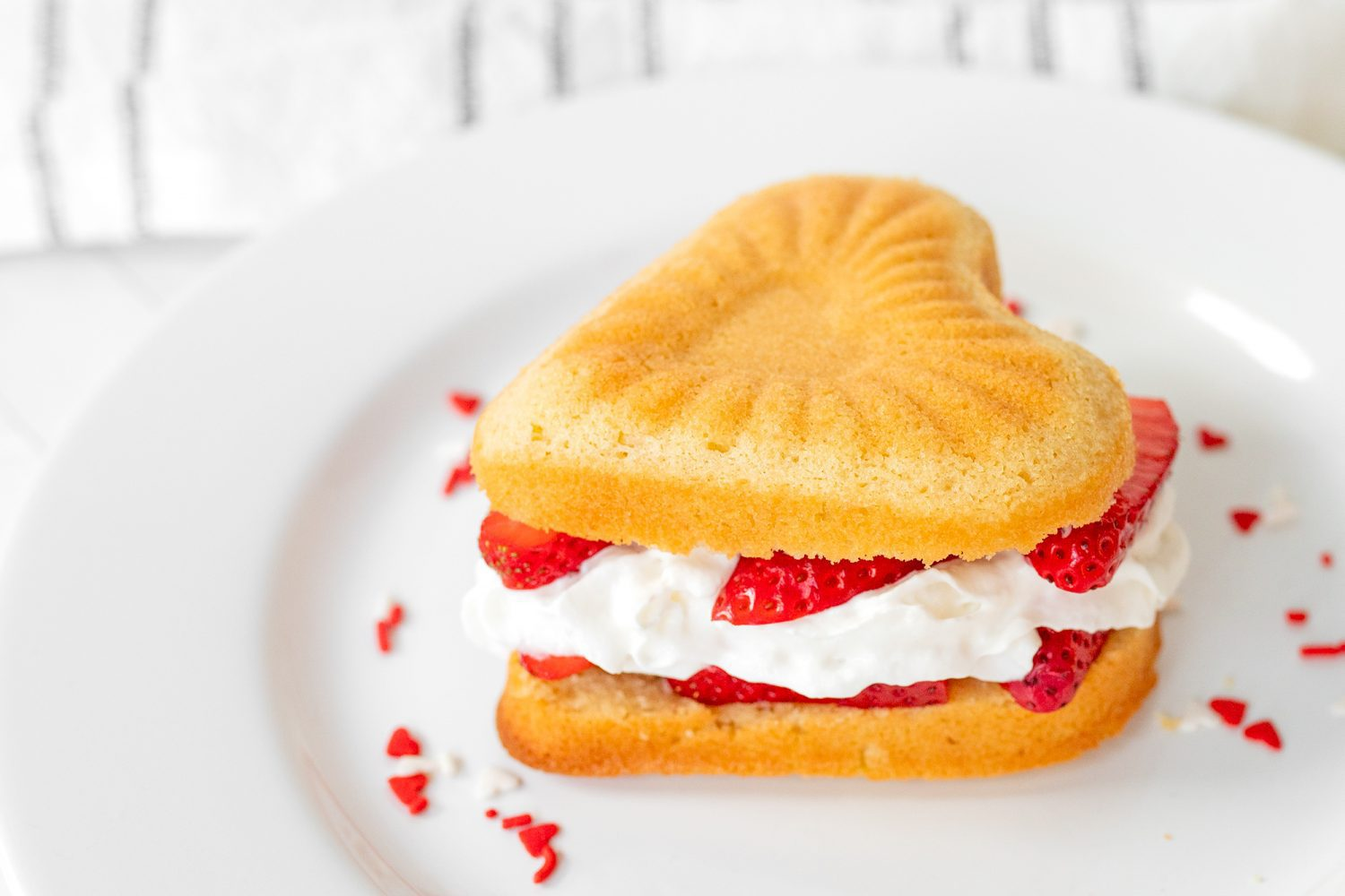 fresh strawberries and whipped cream, sandwiched between two pieces of pound cake