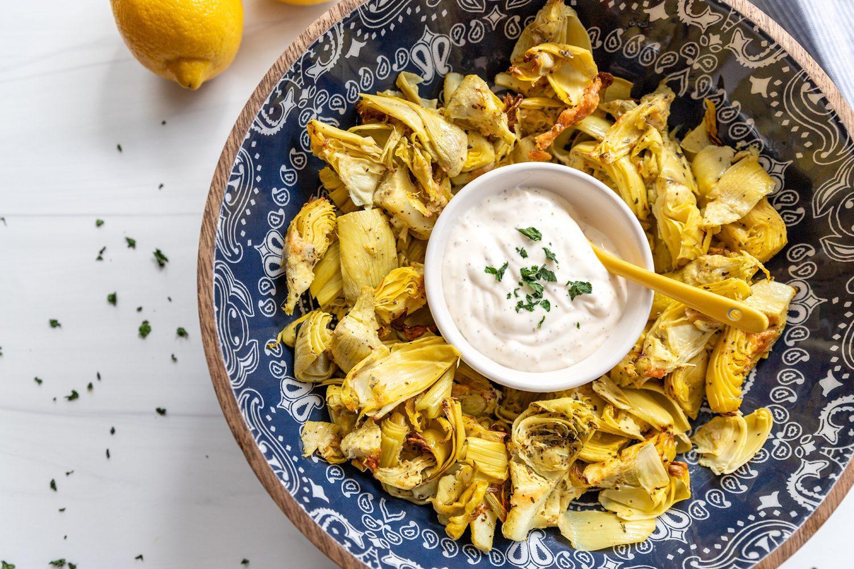 bowl of air fryer artichoke hearts with garlic aioli