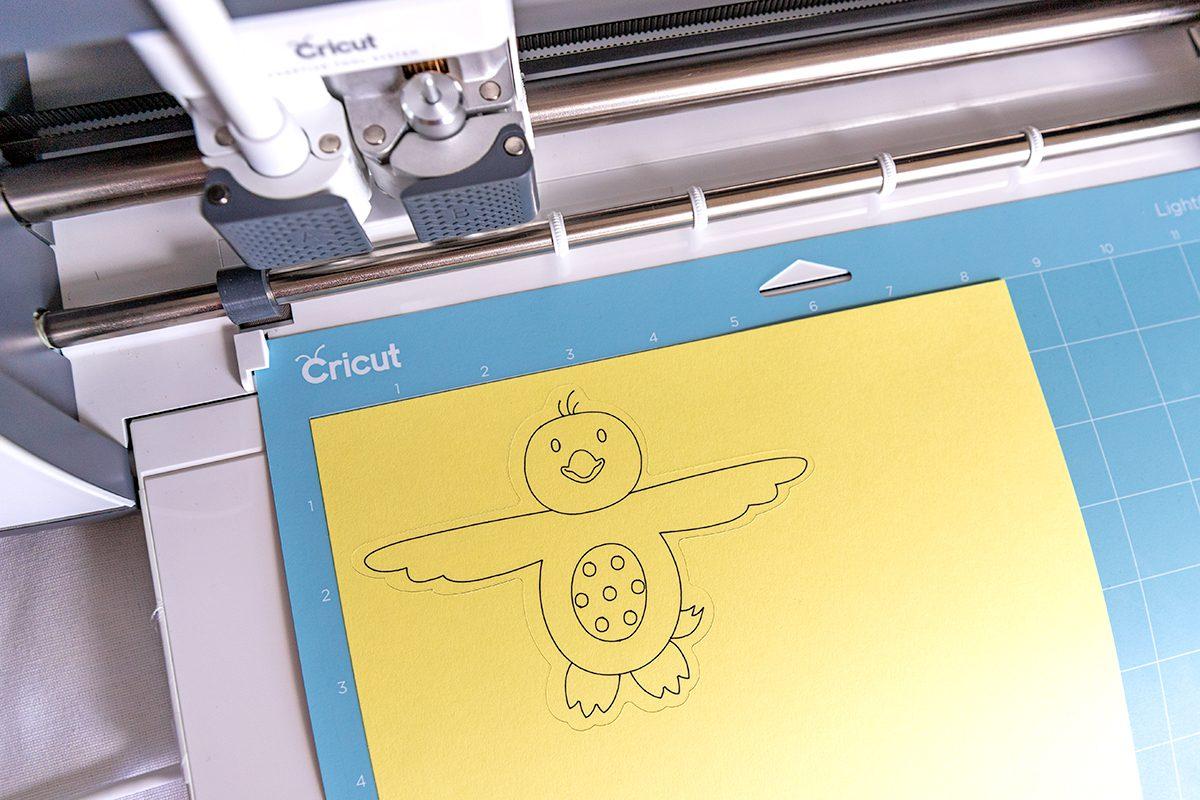 yellow chick on a cricut mat