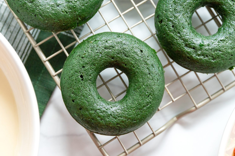 close up of a green velvet donut