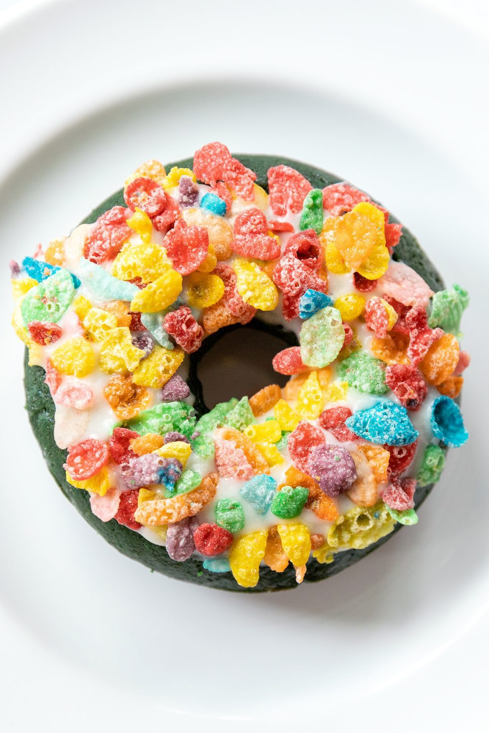 a donut covered with fruity pebbles