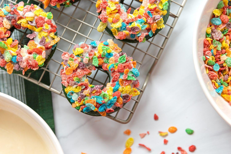 green velvet donuts on a cooling rack