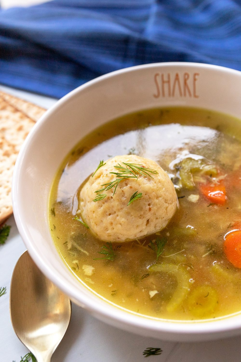 close up of a bowl with matzo ball soup
