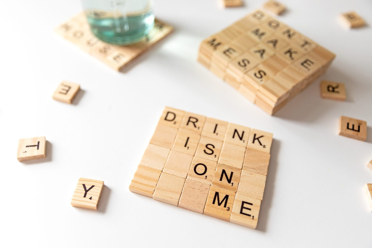 drink is on me coaster