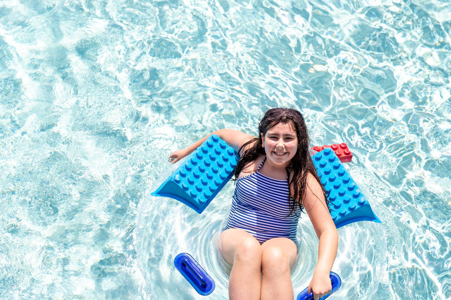 girl on a lego raft at LEGOLAND Water Park