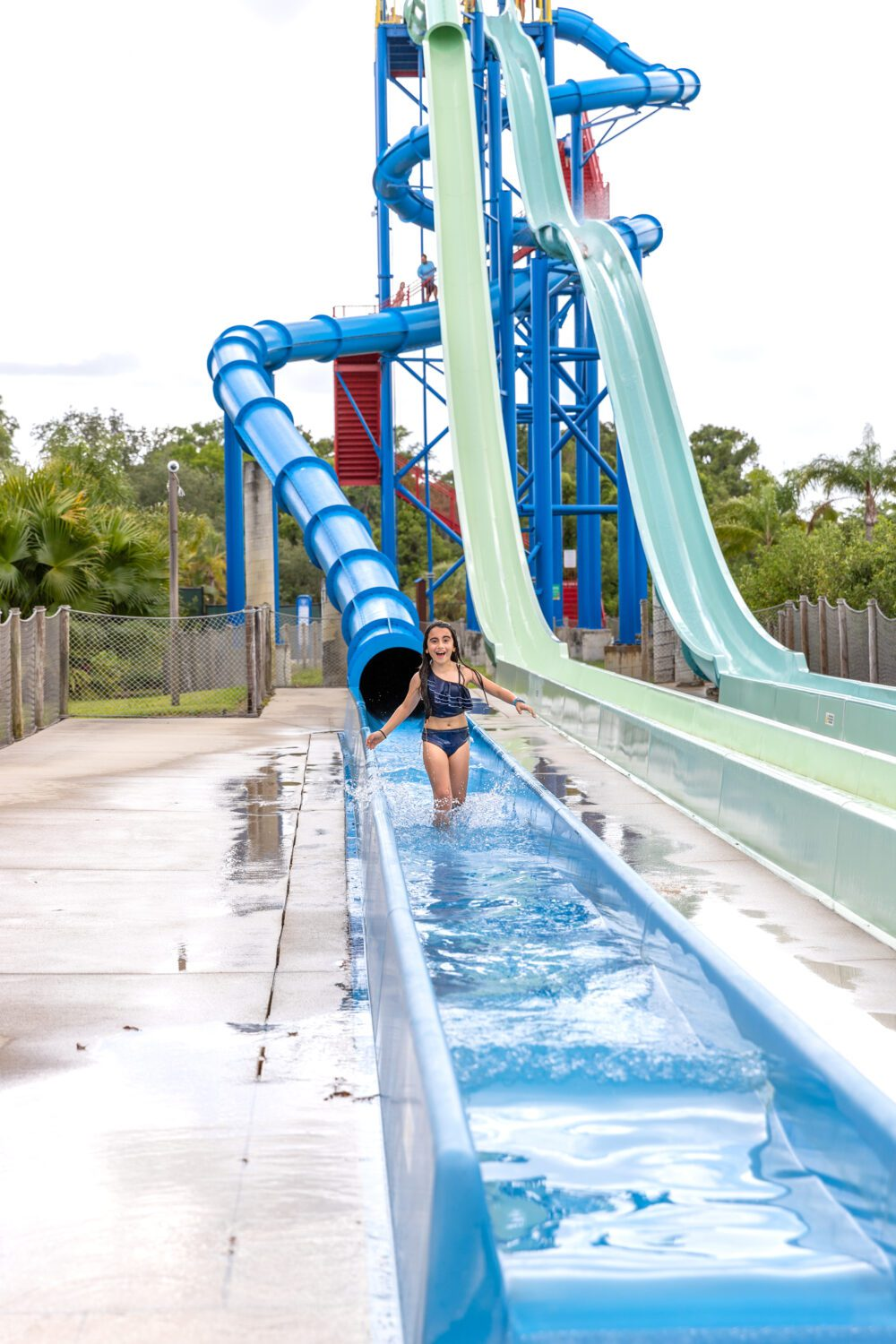 girl walking out of the water slide at LEGOLAND Water Park
