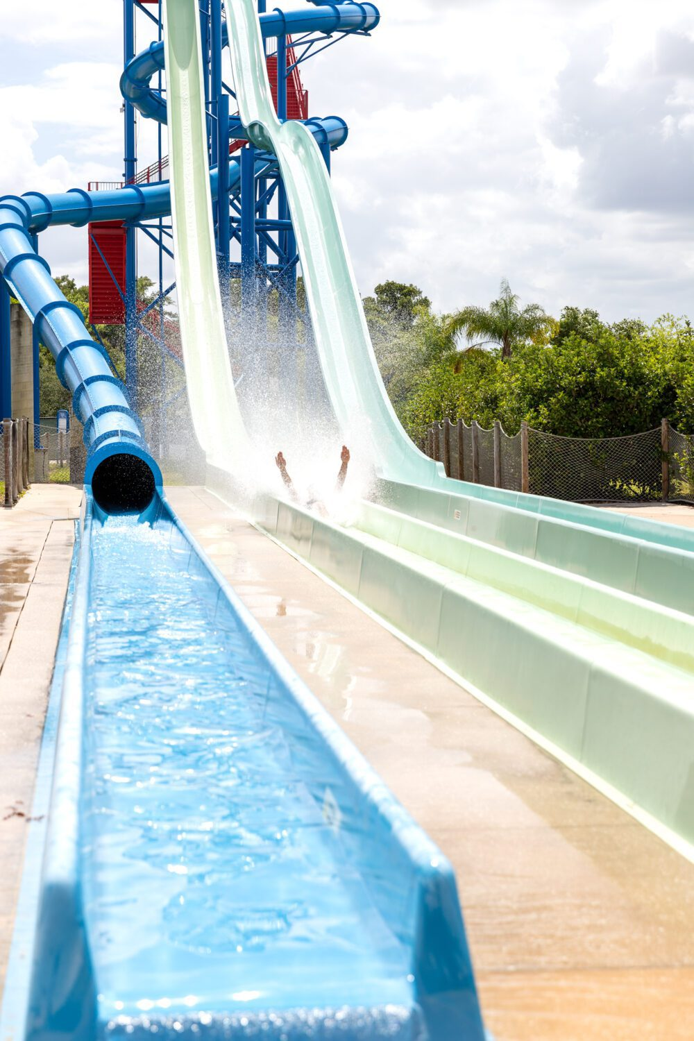 two arms sticking up on a water slide