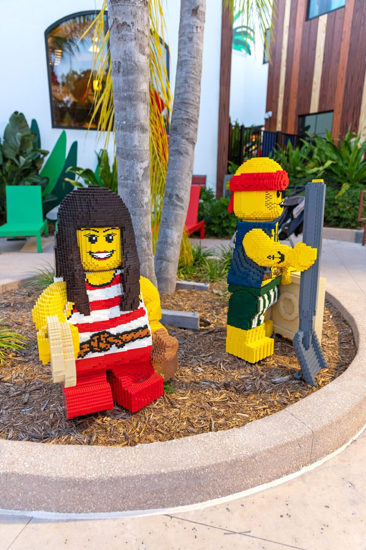large lego people at the pool area of LEGOLAND Florida Resort