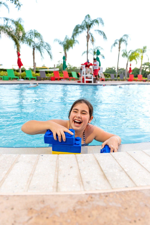 girl having a blast inside of a pool