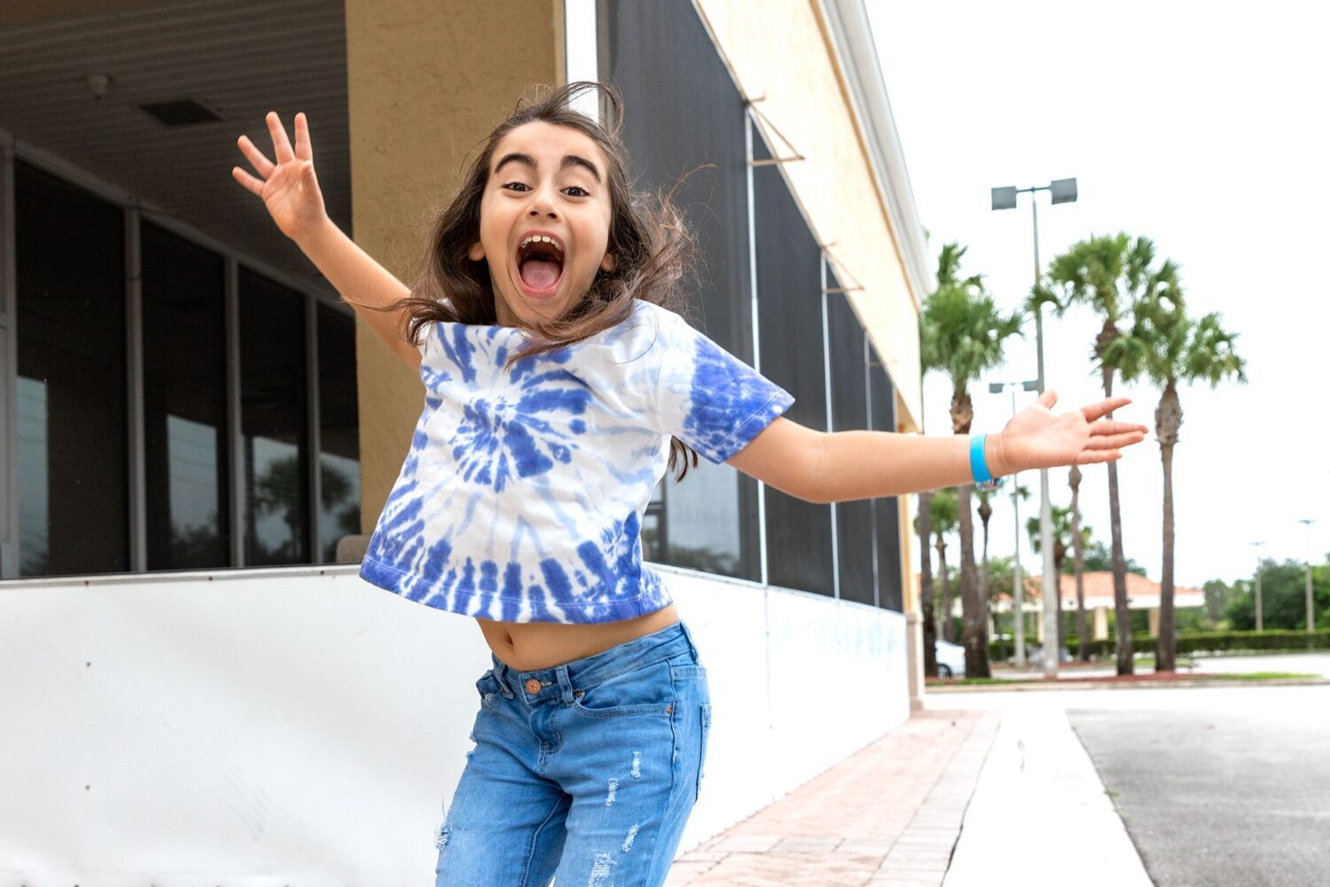 girl jumping in the air our journey with ADHD