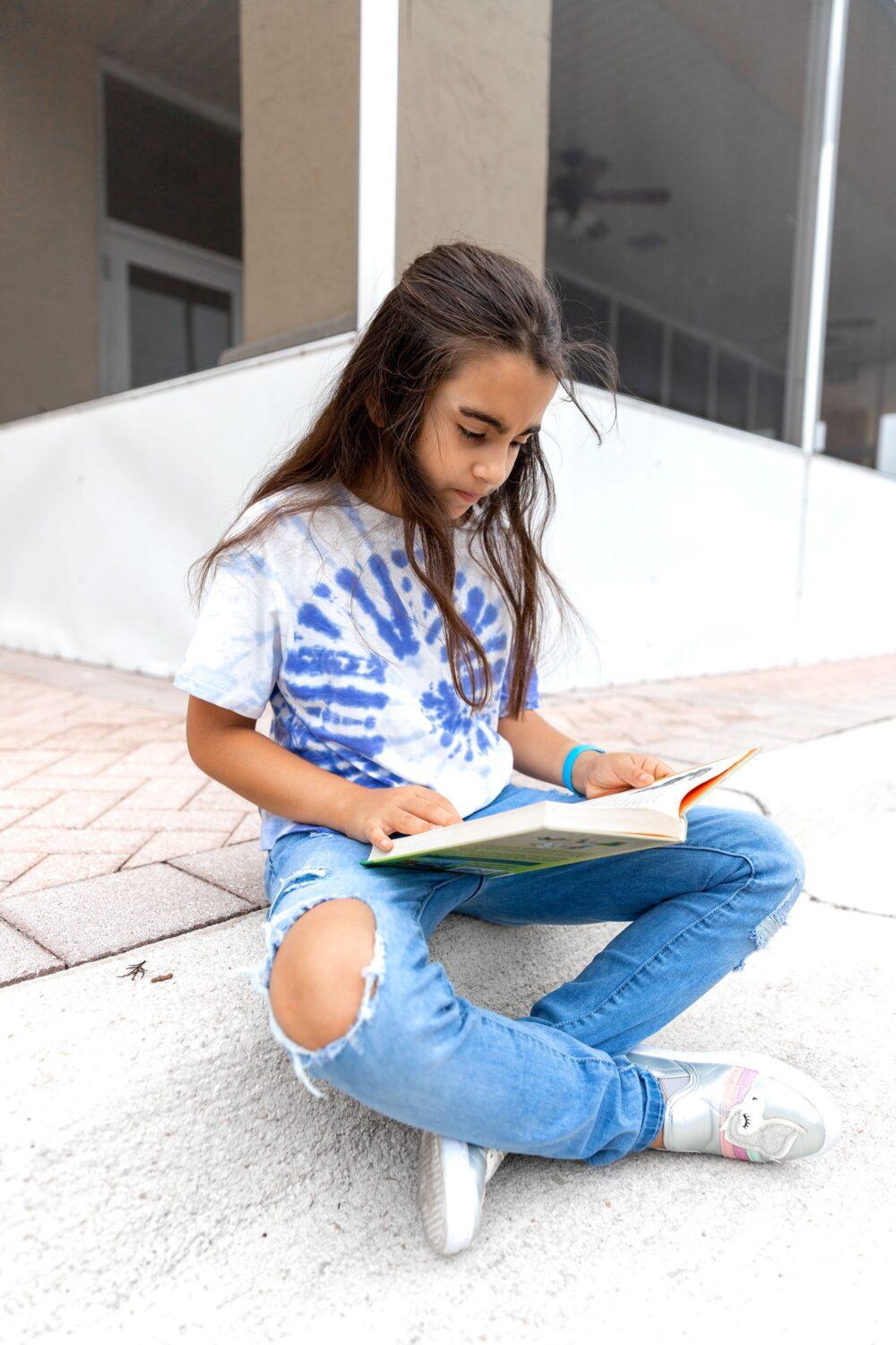 little girl reading a book our journey with ADHD