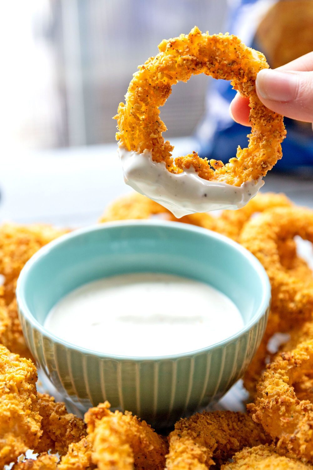 an onion ring that's been dipped into ranch dressing