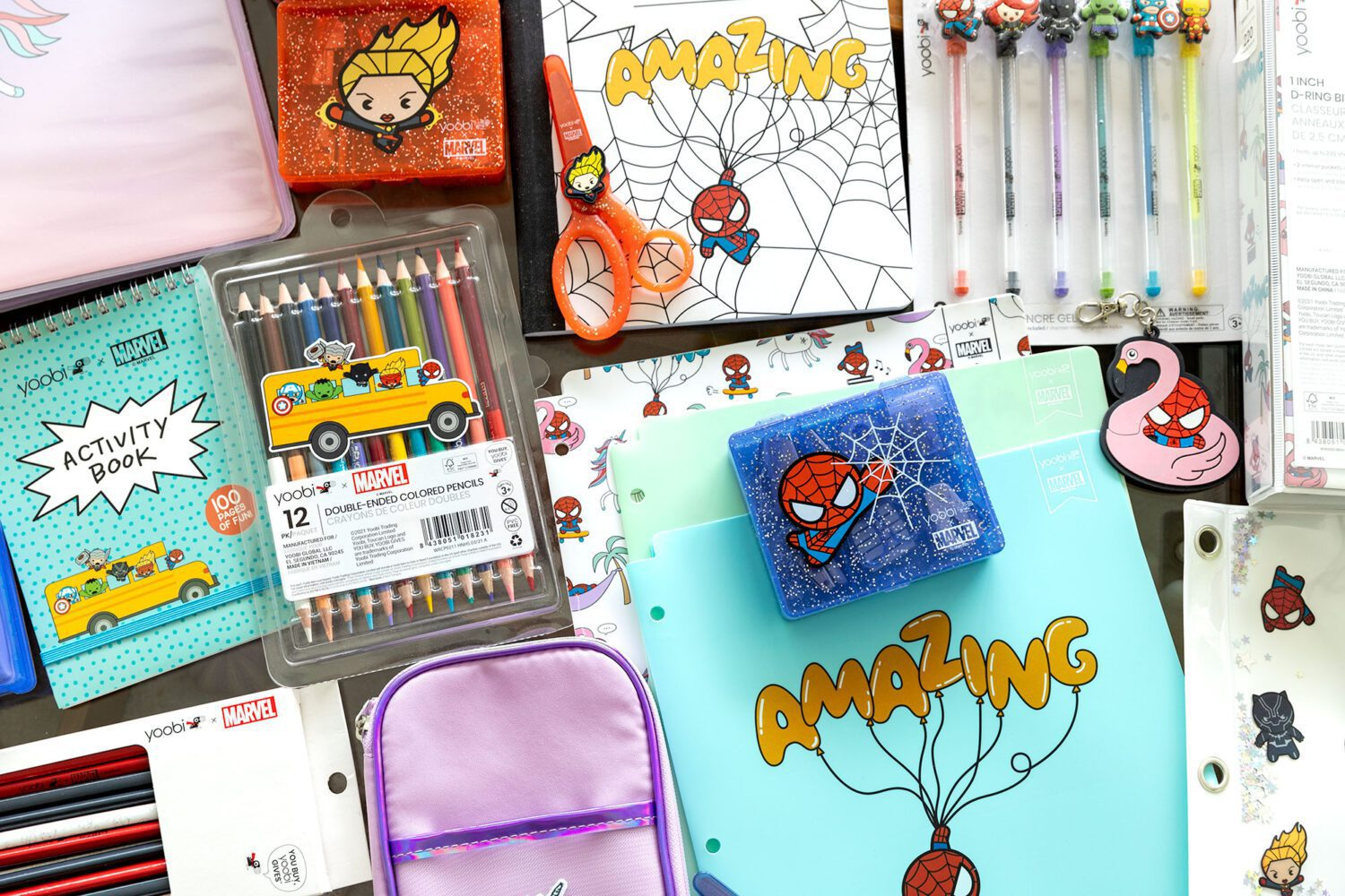New yoobi Marvel collection of school supplies laid out on a table