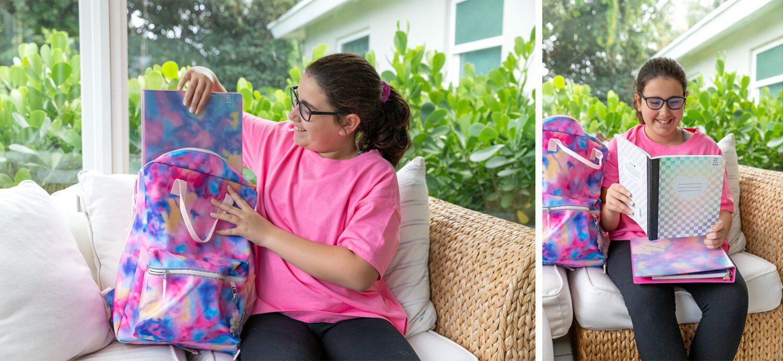 tween showing off her new tie dye school supplies