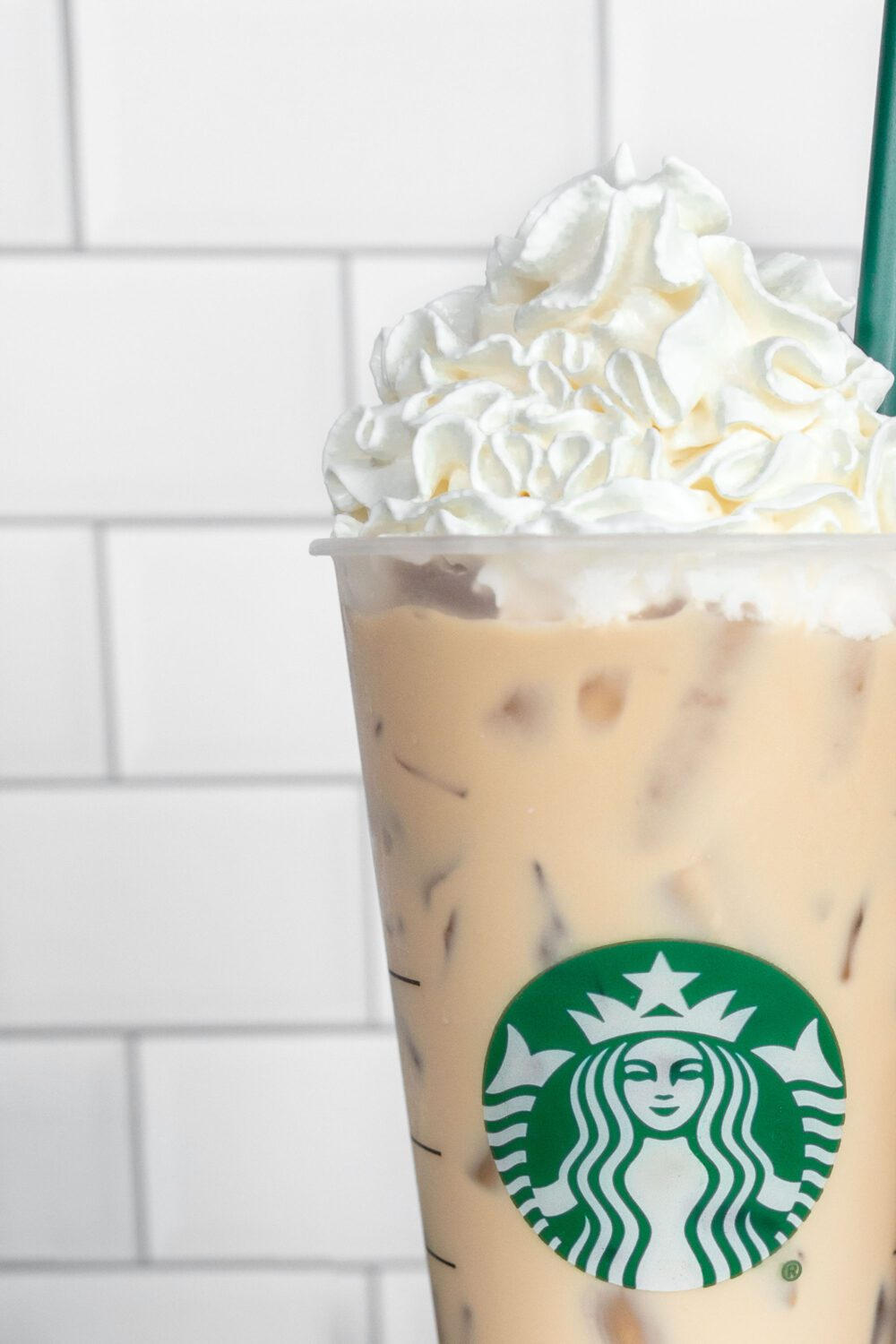 close up of starbucks cup with whipped cream