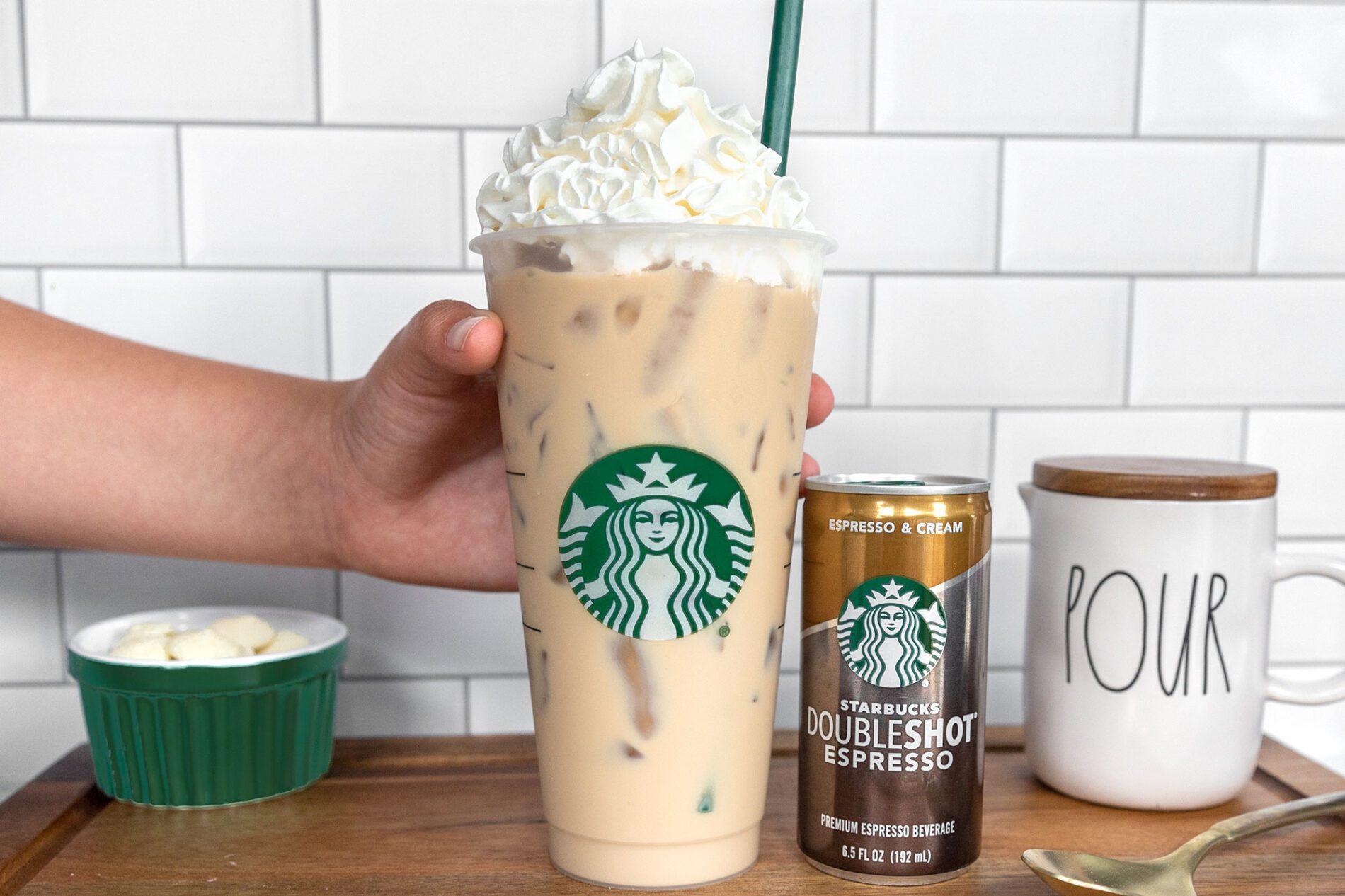 hand grabbing a Starbucks iced white chocolate mocha