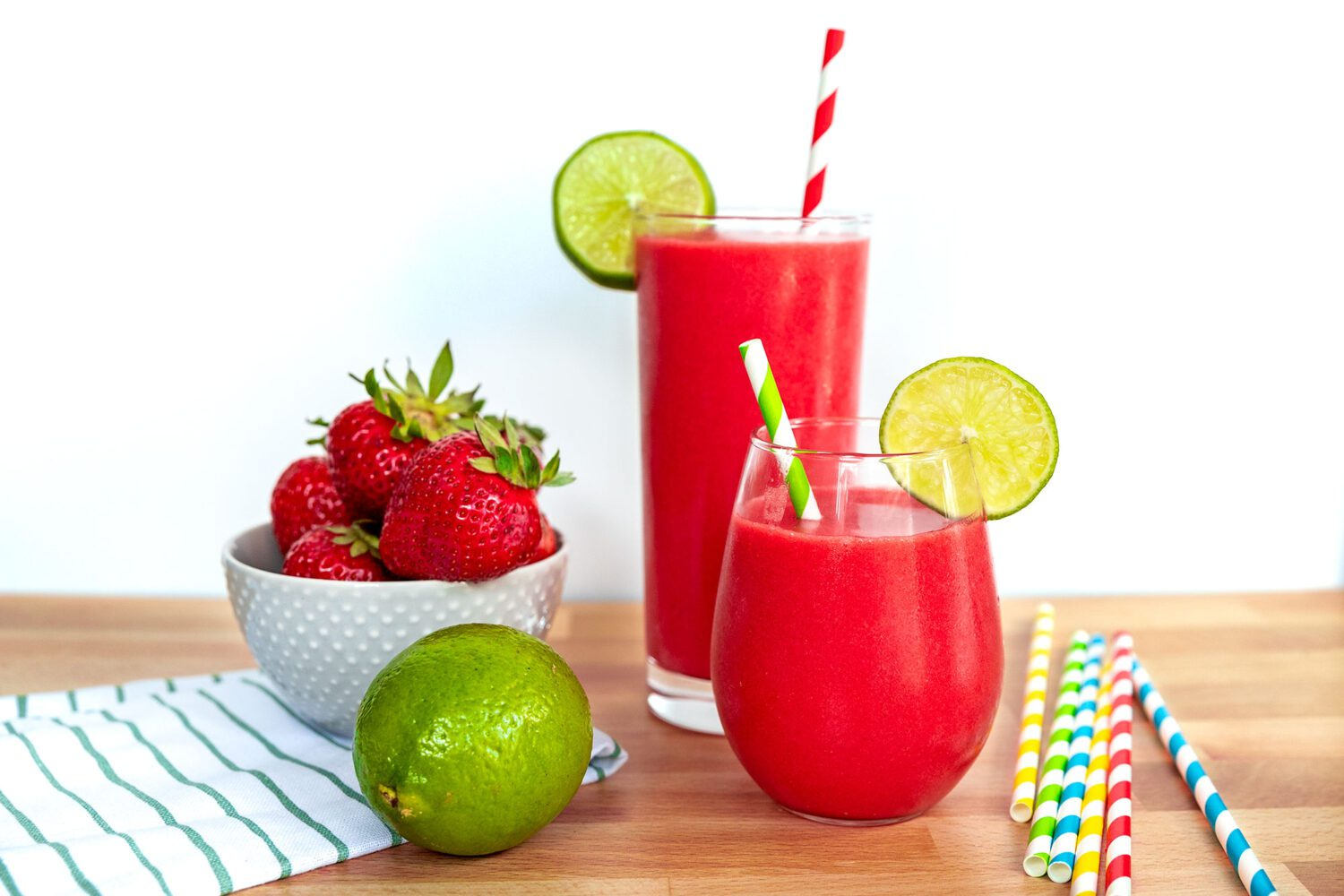 two glasses with strawberry daiquiri mocktails