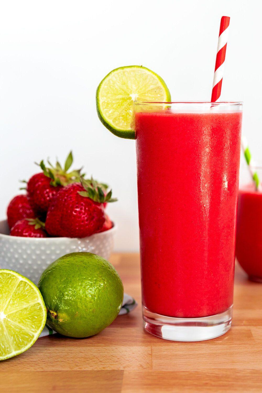 strawberry daiquiri with lime garnish