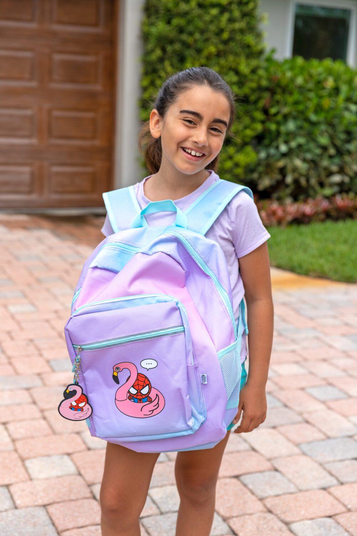 young girl with her new yoobi Marvel backpack