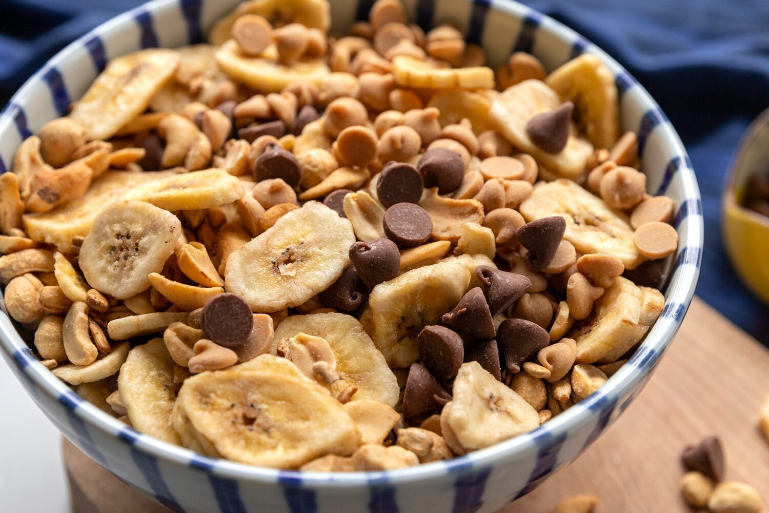close up of trail mix with banana chips and chocolate chips