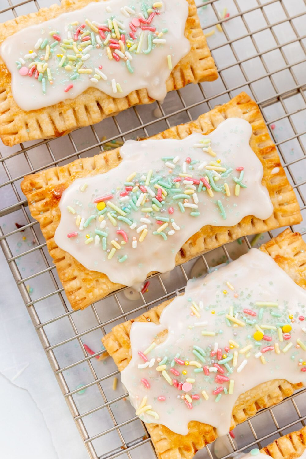 homemade strawberry pop tarts on a cooling rack