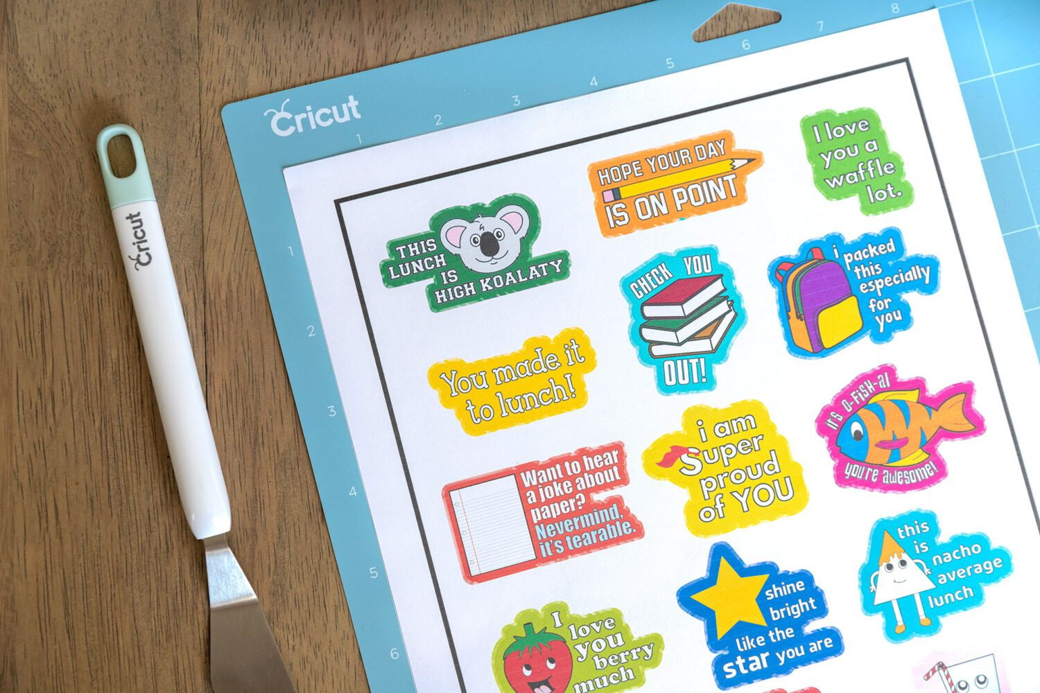 sheet of printable lunchbox stickers on a cricut mat