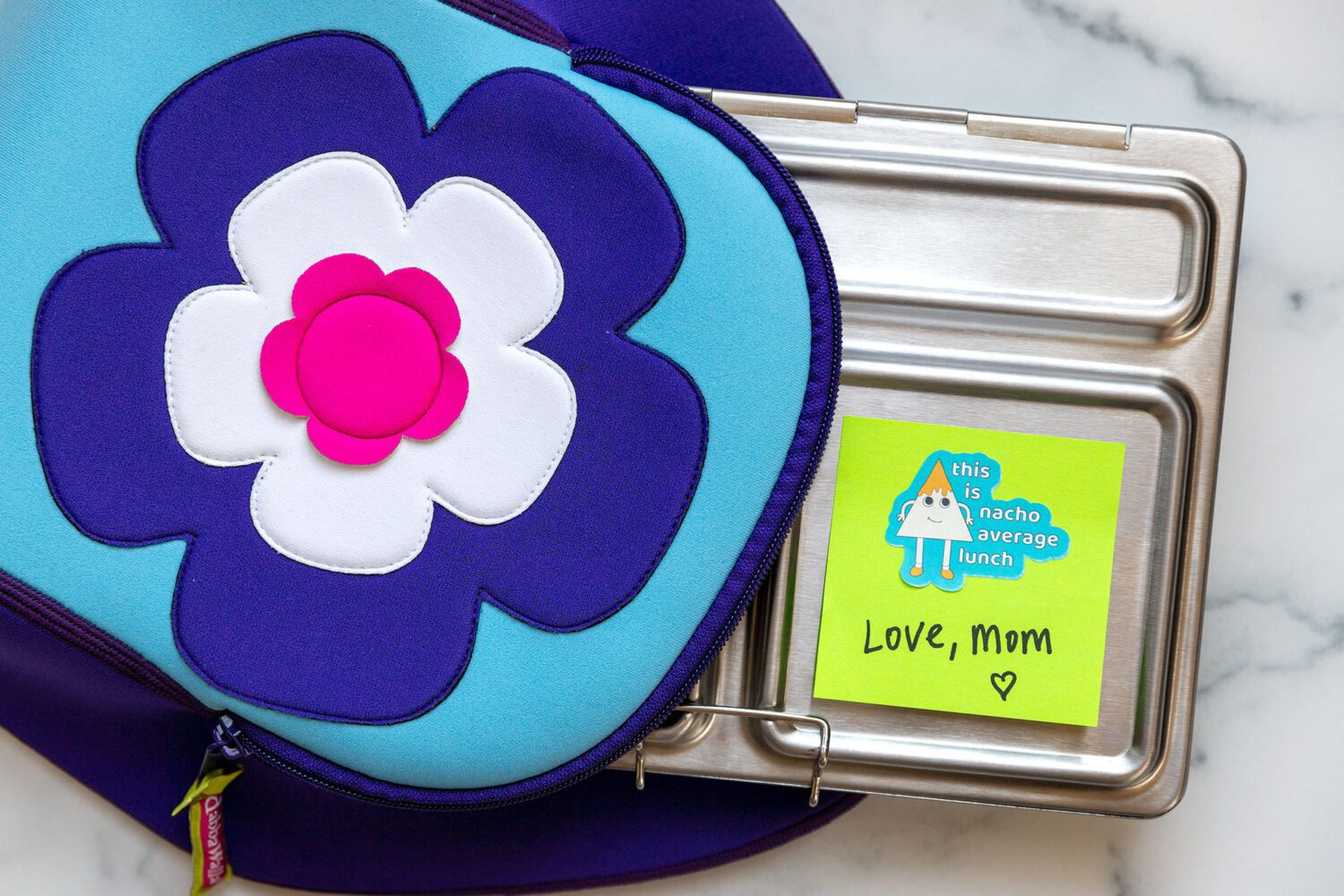 lunchbox with a note from mom and a cute sticker