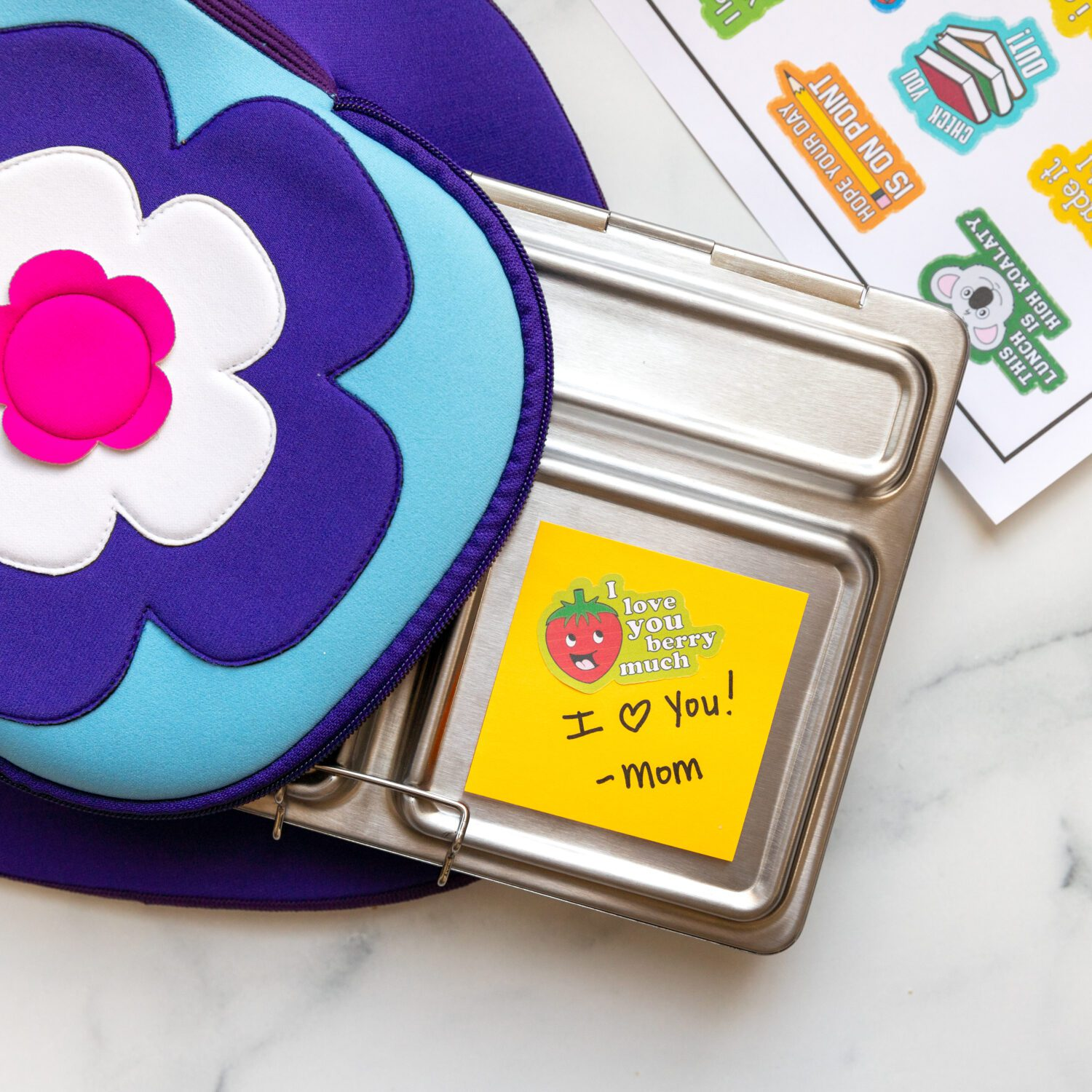 lunchbox with a post it note and a sheet of lunchbox stickers