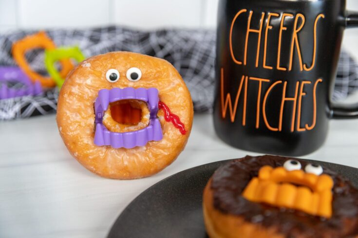donut vampires next to a rae dunn mug that says cheers witches